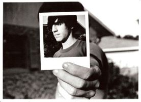Holding a polaroid by itsallforhim04
