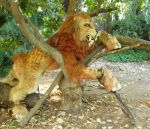 sabertooth quadsuit in a tree by LilleahWest