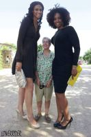 Two tall women and short man by lowerrider