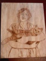 Carving of my friend and her beloved cat by kayanah
