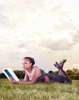 Reading  in the grass by berds