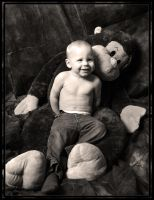 Aiden and his furry friend. by MoonShotPhotos