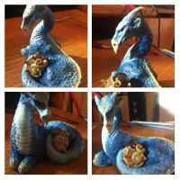 Blue water dragon with her egg by VoodooDollyArtwork