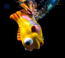 Toy fish and water splash. by Eevl