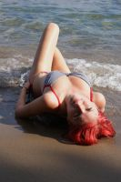 lying on a beach by Ashiwa666