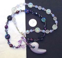 Mitsutomoe magatama necklace by wombat1138