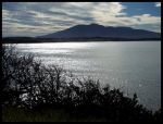 Mountain over sea by Trizzles1