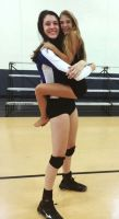 Tall Volleyball player hug by lowerrider