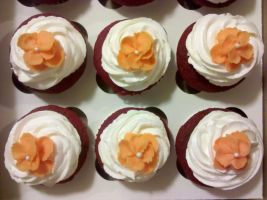Red Velvet Cupcakes with Orange Flowers by missblissbakery