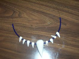 Tooth and Claw Necklace by writergal1