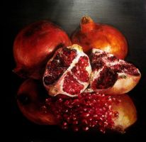 Pomegranates on black by PiskunovSergey
