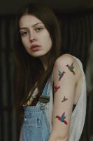 A girl with a tattoo by haania