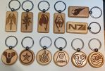 laser engraved wood burned keychains by BahamutDawnCreations