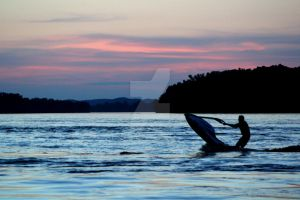 jet ski sunset by lowgearlarry