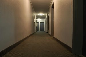 Dark Hallway with Doors by happeningstock