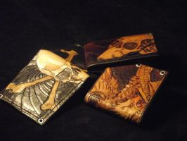 tooled wallets by RomeTheArtist