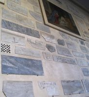 Christian tombstones in wall by metalpug