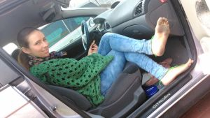 My wife in the car by barefootersk