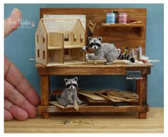 Miniature Raccoon sculptures by Pajutee