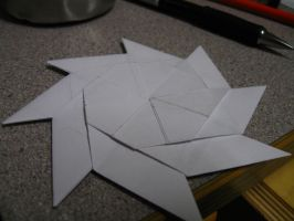 An origami throwing star... with a surprise. by michaelajunker