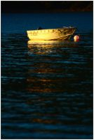 Boat at sunset by wildplaces