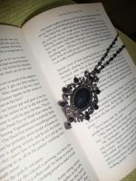 Necklace in a book by Laura-in-china