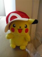 Red's Hat on his Pikachu by SailorUsagiChan