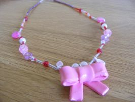 Pink Bow Necklace by Charlotte-Holmes