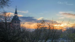 Sunset over my hometown by OliverBPhotography