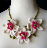 Crochet orchid necklace by meekssandygirl