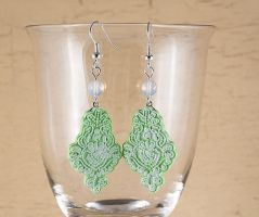 Green polymer clay earrings by skuggsida