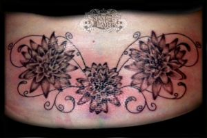 Flowers lower back (sorry for picture quality) by state-of-art-tattoo