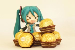 Miku and Ferrero Rocher by negi-bozou
