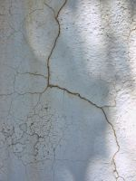 white cement wall cracks by fotophi