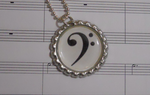 [COMMISSION] Bass Cleff Bottle Cap Necklace by GirlWithTheGreenHat