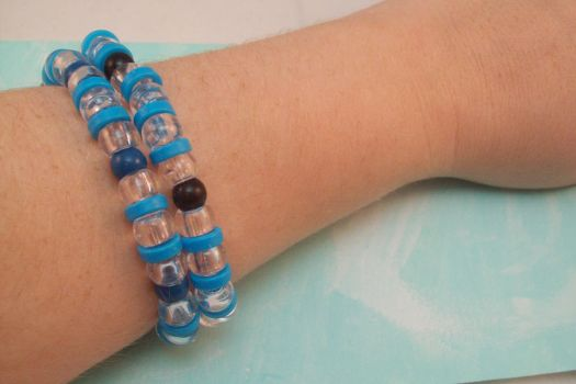 Blue and Clear Plastic Beaded Stretch Bracelet Set by hottyblond2000