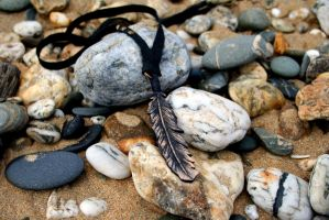 handtooled leather feather necklace by TheRavensDaughter
