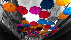 Colored umbrellas in black and white world by jelenag