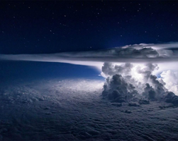 Storm gathering above the clouds over the Pacific. by SlightlyNeurotic