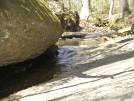 rocks in the creek again by Irie-Stock