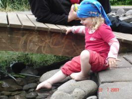 Child In to the pond by Liburnica-stock