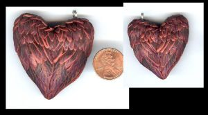 Wing heart pendant by Glori305