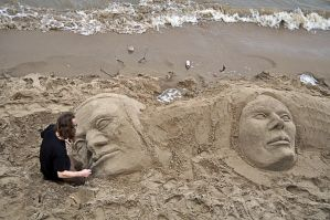 faces on the sand by chimneysweeper