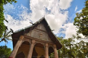 Lao sky and temple by drewhoshkiw