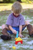 A little boy playing with blocks by Puppers1