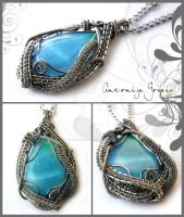 Light blue wirewrapped pendant by Faeriedivine
