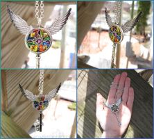 Stained Glass Winged Key Charm Necklace by Tsurera
