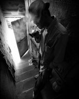 cigarettes and lonely man by hidlight