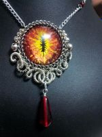 Fire Eye in Silver Coiled Wire with Red Drop by BacktoEarthCreations