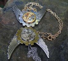 Steampunk sun and moon pendants by Hiddendemon-666